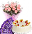 send Eggless Pineapple Cake Pink Roses Bouquet N Chocolate delivery