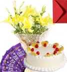 send Eggless Pineapple Cake Lilies Bouquet N Chocolate delivery