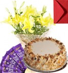 send Eggless Butterscotch Cake Lilies Bouquet N Chocolate delivery