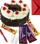 send Eggless Black Forest Cake with Chocolate gift pack n Greeting Card delivery