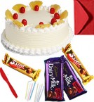 send Eggless Chocolate Pineapple Cake with Chocolate gift pack n Greeting Card delivery