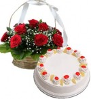 send  Pineapple Cake Half Kg N Red Roses Basket delivery