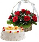 send 1Kg Pineapple Cake N Red Roses Basket delivery