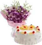 send Pineapple Cake Half Kg N Orchids Bouquet delivery
