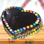 send OrderHalf Kg cadbury games chocolate truffle cake heart shape Delivery