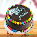 send Order500gms Chooclate Jems Cake Delivery