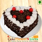 send Eggless Half kg heart shape black forest cake delivery