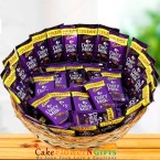 send dairy milk chocolates nicely arranged in basket delivery