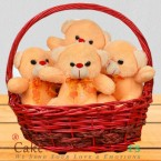 send A basket full of 4 Teddies delivery