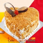 send eggless half kg heart shape butterscotch cake delivery