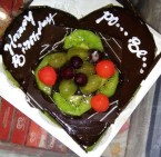 send 1 kg eggless chocolate fruit cake heart shape cake delivery