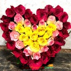 send red pink yellow roses heart shape arrangement delivery