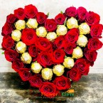 send 16 ferrero rocher chocolate 30 roses heart shape arrangement delivery