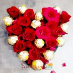 send 16 ferrero rocher chocolate 16 roses heart shape arrangement delivery