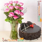send half kg strawberry cake with glass vase of 12 pink roses delivery