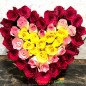 red pink yellow roses heart shape arrangement