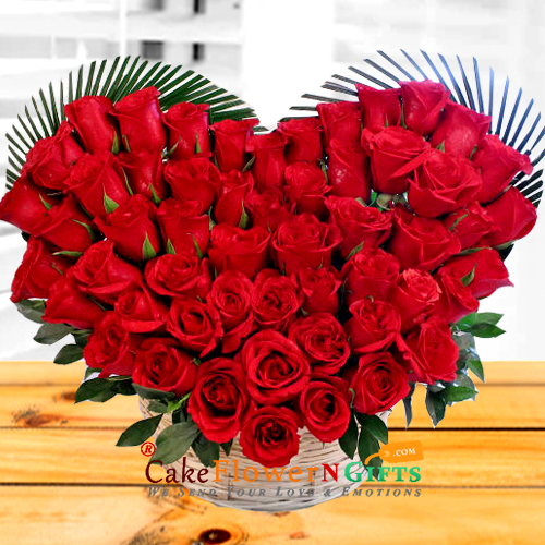heart shaped basket of 50 red roses