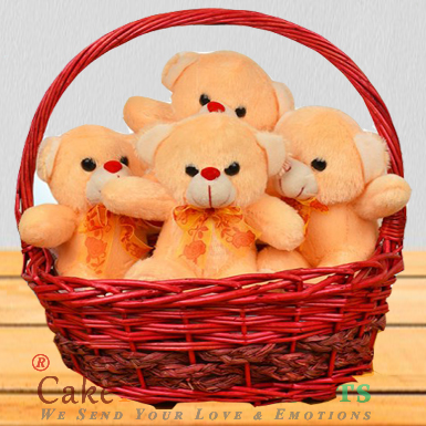 A basket full of 4 Teddies