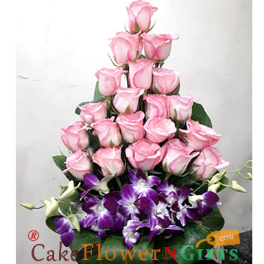 21 pink roses and 3 orchid designer bouquet